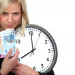 A businesswoman illustrated the concept time is money. — Stock Photo