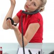 Woman putting her makeup on in the office — Stock Photo