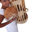 A baker showing off her bread — Stock Photo