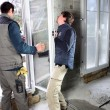 Two men fitting new window — Stock Photo