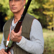 Stock Photo: Hunter with rifle
