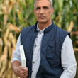 Farmer with computer — Stock Photo #9612693