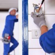 An electrician fixing an outlet. — Stock Photo #9612931