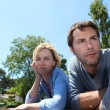 Couple leaning over the water — Stock Photo #9614394
