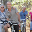 Elderly riding their bikes — Stock Photo #9614716