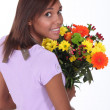 Florist holding a bouquet of flowers - Stock Photo