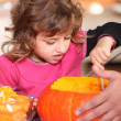Girl pouring pumpkin — Stock Photo