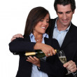Happy couple celebrating event with champagne — Stock Photo
