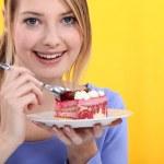 Woman eating strawberry cake — Stock Photo