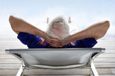 Senior relaxing in a deckchair — Stock Photo
