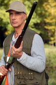 Cazador con rifle — Foto de Stock