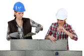 Two female mason working on a wall. — Stock Photo