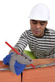 Tradesman marking a measurement with a pencil — Stock Photo