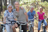 Elderly riding their bikes — Stock Photo