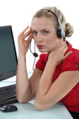 Blond secretary with headache — Stock Photo