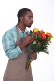 Afro-American flowers retailer — Stock Photo
