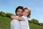 Father and daughter walking in a field together — Stock Photo