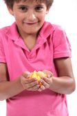 Little boy holding pieces of fruit — Stock Photo