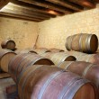Stock Photo: Wine barrels in a cellar