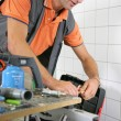 Plumber working in the bathroom — Stock Photo
