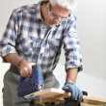 Tradesman using a jigsaw — Stock Photo