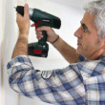 Handyman using drill — Stock Photo #9670321