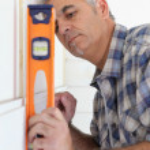 Handyman using spirit level — Stock Photo #9670329