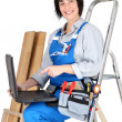 Female carpenter with her laptop — Stock Photo #9670361