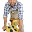 Young carpenter on white background — Stock Photo