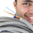 Stock Photo: Tradesmcarrying corrugated tubing