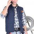 Stock Photo: Electricimaking call to supplier