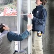 Two men installing new windows — Stock Photo
