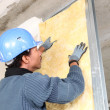 Stock Photo: Mfitting wall insulation