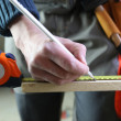 Carpenter marking a piece of wood - Stock Photo