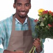 Stock Photo: Florist with bouquet of flowers on white background