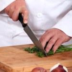 Chef chopping parsley — Stock Photo