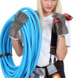 Foto Stock: Female plumber