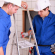 Two electricians watching plan — Stock Photo