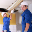 Electricians installing neon lights in the ceiling — Stock Photo