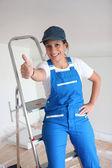 Female decorator happy with progress — Stock Photo