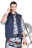 Electrician making call to supplier — Stock Photo