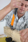 Man removing nails using his hammer — Stock Photo