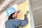 Man fitting wall insulation — Stock Photo