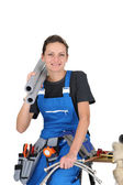 Female plumber with various tools and materials — Stock Photo