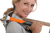 Woman with hammer — Stock Photo