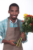 Florist with bouquet of flowers on white background — Stock Photo