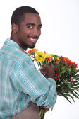 Male florist with a bunch of flowers — Стоковое фото