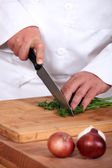 Chef chopping parsley — Stock Photo
