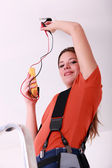 Woman with voltmeter — Stock Photo