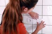 Women adjusting switch — Stock Photo